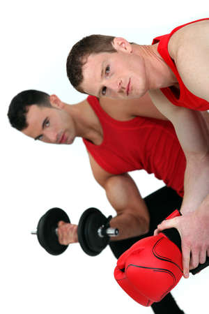 pectorals: muscular fellow lifting weight and guy with boxing gloves
