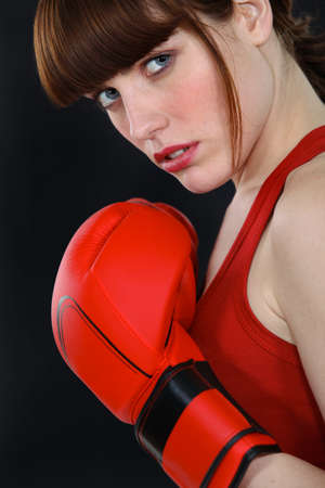 woman tied: A determined female boxer Stock Photo