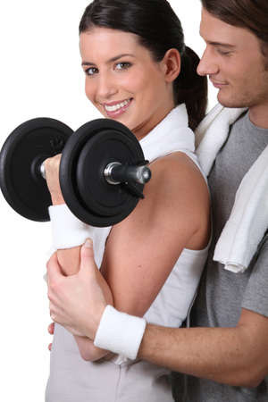 wristbands: Woman lifting a dumbbell Stock Photo