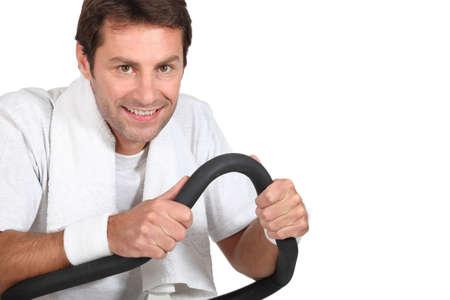 machine man: Man using a running machine in a gym