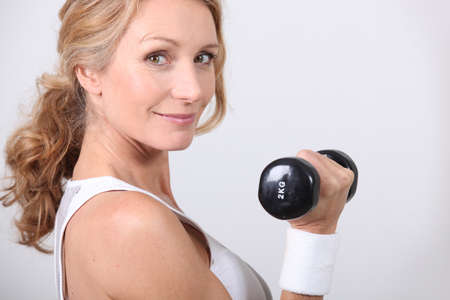 35 39 years: portrait of a woman with dumbbell Stock Photo