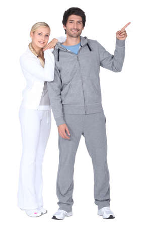 running pants: A couple of runners pointing sideways Stock Photo
