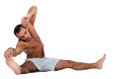 barefoot man: Man stretching