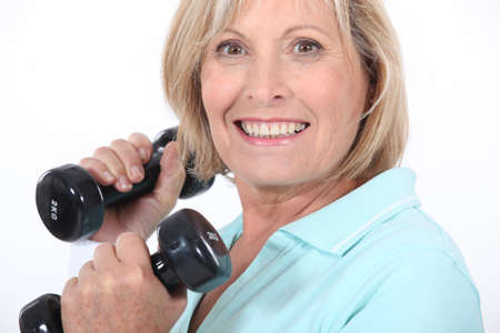 boomer: A middle age woman lifting weights