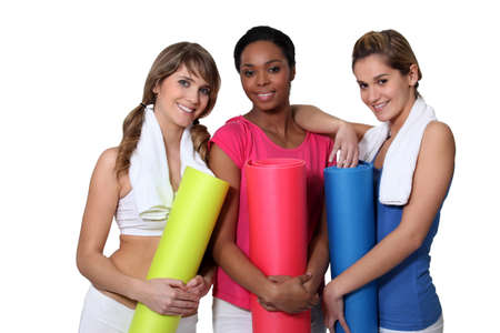 Young women going to yoga class together photo