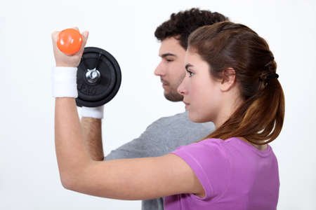 couple lifting weights in profile photo
