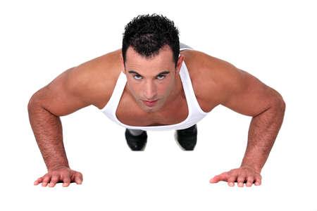 warm up: Man doing push-up Stock Photo