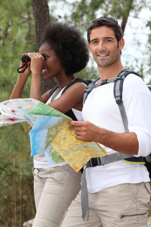 khaki pants: Couple hiking in the countryside
