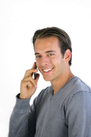 slicked back hair: Smiling man talking on his mobile phone