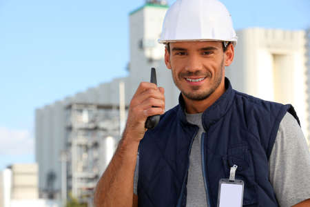 Construction worker speaking into his walkie-talkie photo