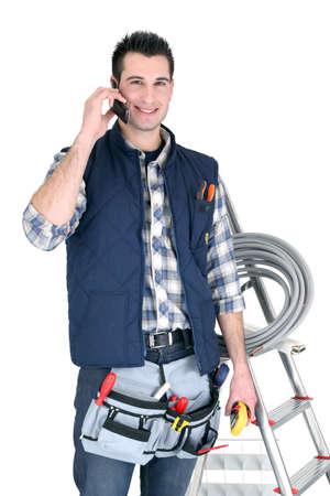 journeyman technician: Electrician on white background Stock Photo