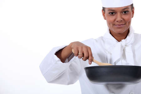 alehouse: female cook with a high-sided frying pan and a wooden spoon