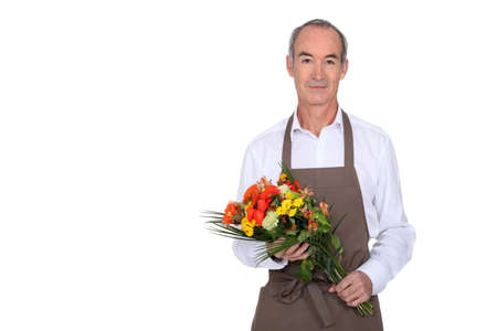 median age: Man with bouquet of flowers Stock Photo