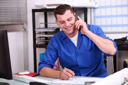craftsperson: Builder in the office Stock Photo