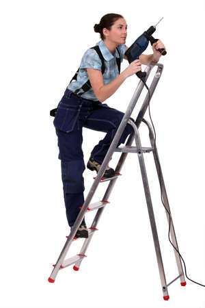 Woman with drill climbing ladder Stock Photo - 15391478