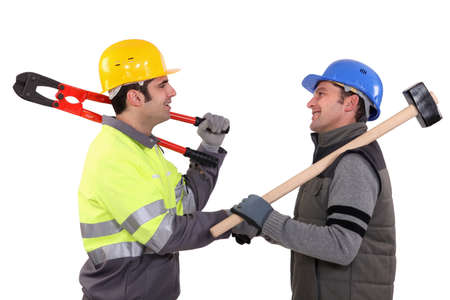 camaraderie: Construction workers shaking hands