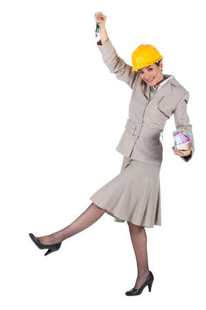 Woman jumping with keys in hand