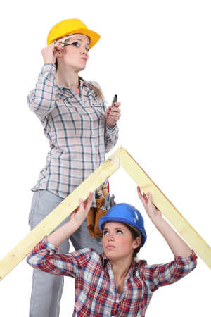 Two female carpenters Stock Photo - 15391722