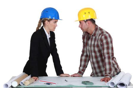 banter: Two architects flirting Stock Photo