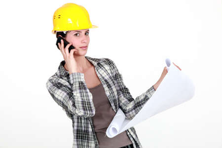 construction draftsman: A foreman on the phone going over the plans  Stock Photo