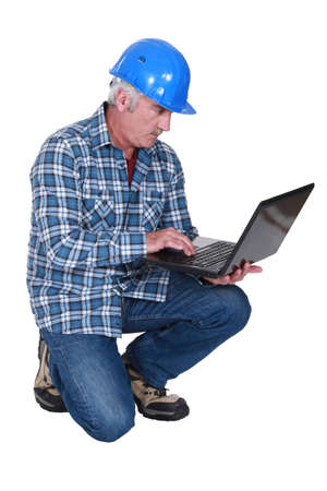 eager: Construction foreman embracing technology Stock Photo