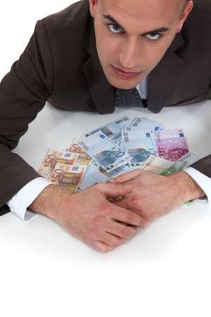 gaze: cupid bankier met dreigende blik Stockfoto