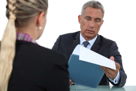 candidate: Businessman interviewing a candidate Stock Photo