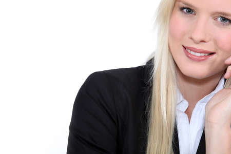 bleached: Studio closeup of young beautiful blonde in a suit Stock Photo