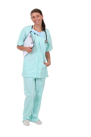 30 34 years: Woman in scrubs with stethoscope and clipboard