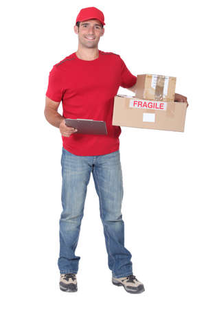 Courier with parcels and clipboard photo
