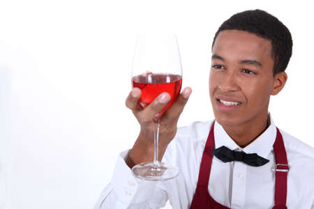 grabbing hand: Looking glass of wine waiter Stock Photo