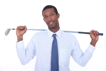 Man with golf club photo