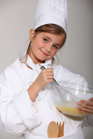 baker's: portrait of a little girl in baker clothes Stock Photo