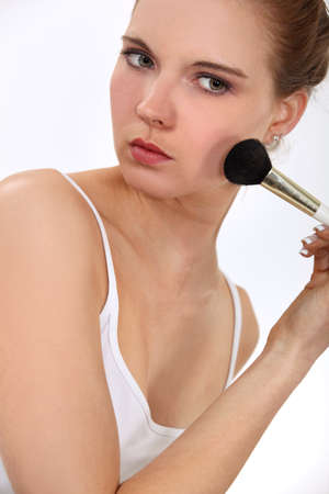 Woman with a blusher brush photo