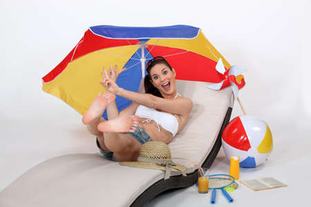Girl jumping on hammock with beach accessories photo