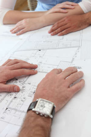 Close-up of architects examining floor-plans photo