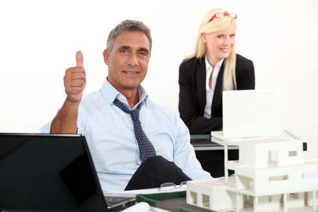 property agent: Estate agent with thumbs up Stock Photo