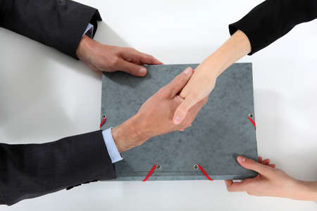 ovation: Businesspeople making a deal Stock Photo