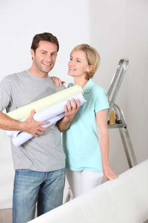 portrait of a couple with wallpaper photo