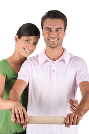 dutiful: Couple with a rolling pin Stock Photo
