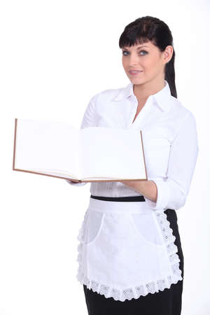 Waitress holding menu photo