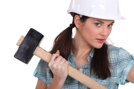 Female construction worker holding a mallet Stock Photo