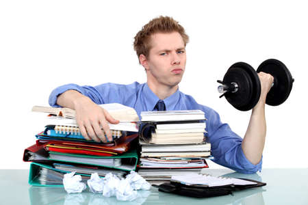 lifting hands: businessman taking care of the documents and doing exercises Stock Photo
