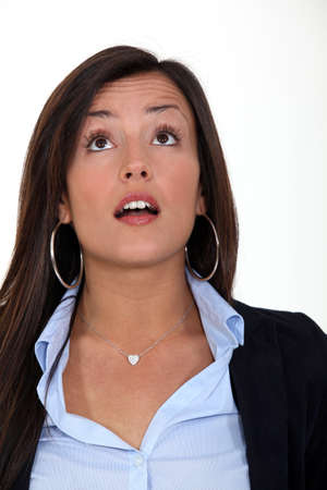 wrinkled brow: A surprised woman looking up at something