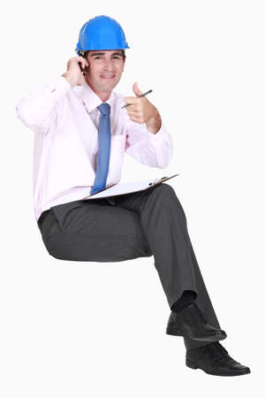 Thumbs up from a businessman in a hardhat Stock Photo - 15391565