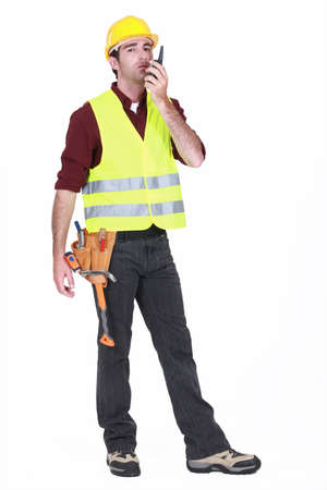 Workman using walkie-talkie on white background Stock Photo - 15391486