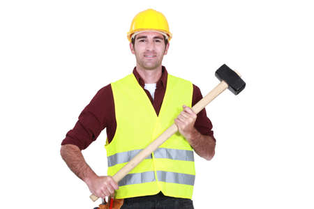 high visibility: Labourer holding a mallet