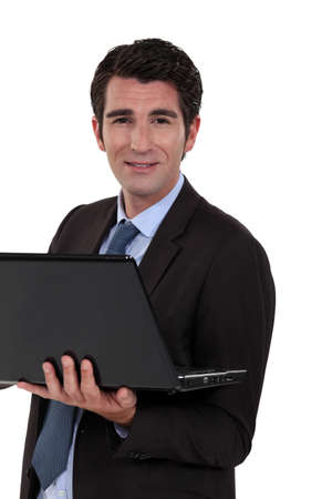 practical: Executive with computer in hand Stock Photo