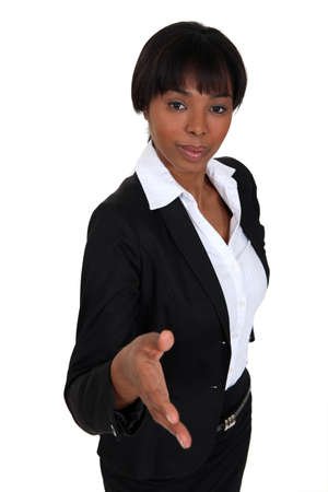 Businesswoman proffering her hand photo