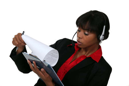 callcenter: Call-center worker with clip-board Stock Photo